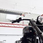 A motorbike and above a Schwank tube heater from the calorSchwank range.
