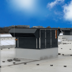 Air handling units on the roof of a large building under a blue sky.